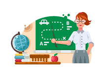 School teacher stands near blackboard Stock Photo
