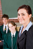 School teacher and student. Young beautiful high school teacher and student Stock Image