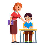 School teacher watching her student boy writing. School teacher standing watching, helping, encouraging her student putting hand on his shoulder. Boy kid in royalty free illustration