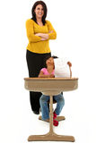 School Teacher With Young African American Child. Sitting In A Desk Holding A Picture Royalty Free Stock Photos