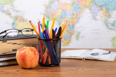 Free School Teachers Desk With World Map In Background Royalty Free Stock Photos - 150119708