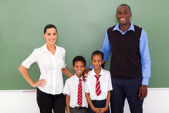 School teachers students. Group of primary school teachers and students in classroom stock image