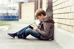 School teen with electronic tablet sitting Stock Photo