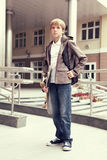 School teen with schollbag and skateboard Royalty Free Stock Image