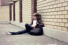 School teen with schoolbag and skateboard Royalty Free Stock Photography