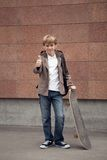 School teen with schoolbag and skateboard Stock Photography