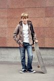 School teen with schoolbag and skateboard Royalty Free Stock Photos