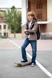 School teen with schoolbag and skateboard Stock Image