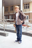 School teen with schoolbag and skateboard Royalty Free Stock Images