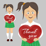 School teenager girl holding red heart with thank you text. School teenager girl holding a red heart with thank you text Stock Photos