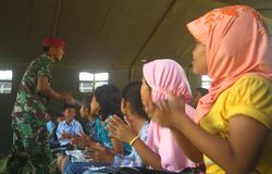 School tend. Indonesian army teach merapi eruption refugees kids in a tend because their school broken by the eruption in Klaten, central java, indonesia royalty free stock photo