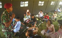 School tend. Indonesian army teach merapi eruption refugees kids in a tend because their school broken by the eruption in Klaten, central java, indonesia stock photos