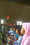 School tend. Indonesian army teach merapi eruption refugees kids in a tend because their school broken by the eruption in Klaten, central java, indonesia royalty free stock photography