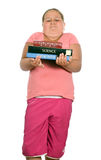 School Text Books. A young girl is holding some of her heavy school text books, isolated against a white background Stock Photography
