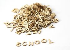 School text with wooden letters. royalty free stock photo