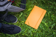 School things on grass. Stock Photo