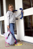 School time. Young grade school age girl heading off to school Royalty Free Stock Images