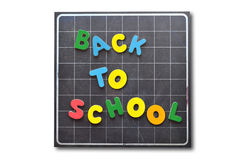School time. Back to school written with wooden letters over a blackboard isolated Stock Images