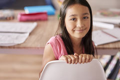 School time. Asian ethnicity girl sitting on the chair Royalty Free Stock Photos