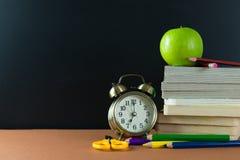 School time. Back to school theme using school supplies and blackboard Stock Photo