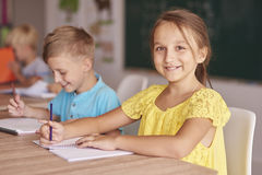 School time. Boy and girl in one desk Stock Photography
