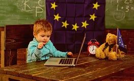 School time. School boy use laptop in classroom with eu flag. Little boy study computer in elementary school. I got. School spirit royalty free stock image