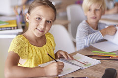 School time. Girl during her everyday duties at school Royalty Free Stock Photo
