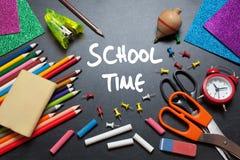 School time. School tools around. Blackboard background Stock Photo