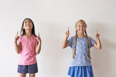 School time. Two friends with fingers up Royalty Free Stock Image