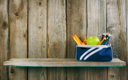 School tools in a case. On wooden background. Stock Photos