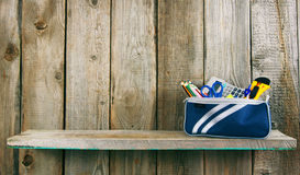School tools in a case. On wooden background. Royalty Free Stock Images