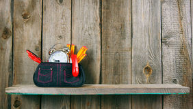 School tools in a case. On wooden background. Royalty Free Stock Photos