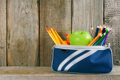 School tools in a case. On wooden background. Royalty Free Stock Image