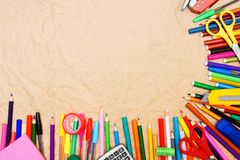 School tools on a rumpled paper. Stock Images