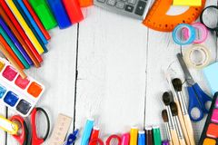 School tools. On white, wooden background. Royalty Free Stock Images