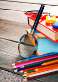 School tools. On wooden background. Stock Photo