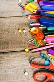 School tools. On wooden background. Stock Photos