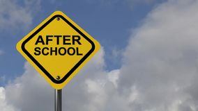 """After school. A traffic sign with the text """"after school"""" against cloudy skies stock video"""