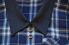 School uniform. Closeup shot of blue tartan school dress uniform for girl stock images