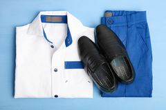 School uniform for a boy. On a blue background. Top view stock image