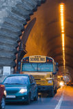 School us. Traditional school bus coming out of a tunnel Stock Photo