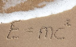School vacation. Writings in the sand on the beach symbolizing school vacation Stock Image