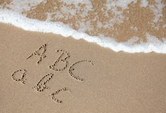 School vacation. Writings in the sand on the beach symbolizing school vacation Royalty Free Stock Photos