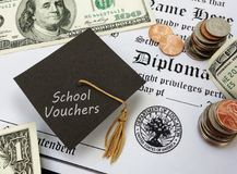 School vouchers concept. High school diploma with School Vouchers text on a graduation cap Royalty Free Stock Images