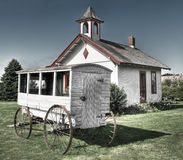 School Wagon in Front of One-Room Schoolhouse Stock Image