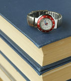 School watches. Stack of books and school watches Royalty Free Stock Photos
