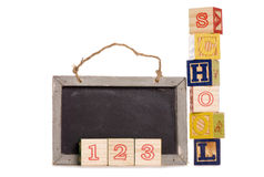 School wooden blocks and black board Royalty Free Stock Image
