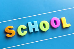 School word on blue board. School word on a blue board Royalty Free Stock Photo