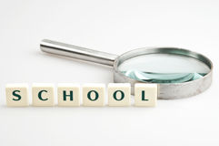 School word and magnifying glass Stock Image