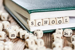 School word written on a wooden block. Stock Images